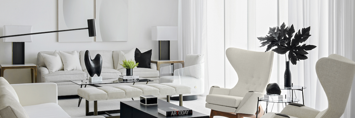 a living room with a mix of black and white design details