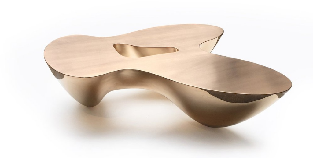 Emmanuel Babled's Quark Bronze coffee table, on view at Twenty First Gallery, illustrates asymmetrical and organic shapes in design.