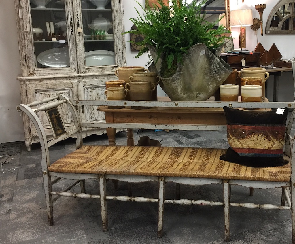The Silk Purse Antiques had antiques in their stand at AmericasMart that introduce heavy doses of patina in interior design.