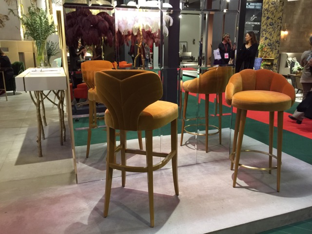 Meloday and Olympia counter stools from Munna in cinnamon hues in lush fabrics.