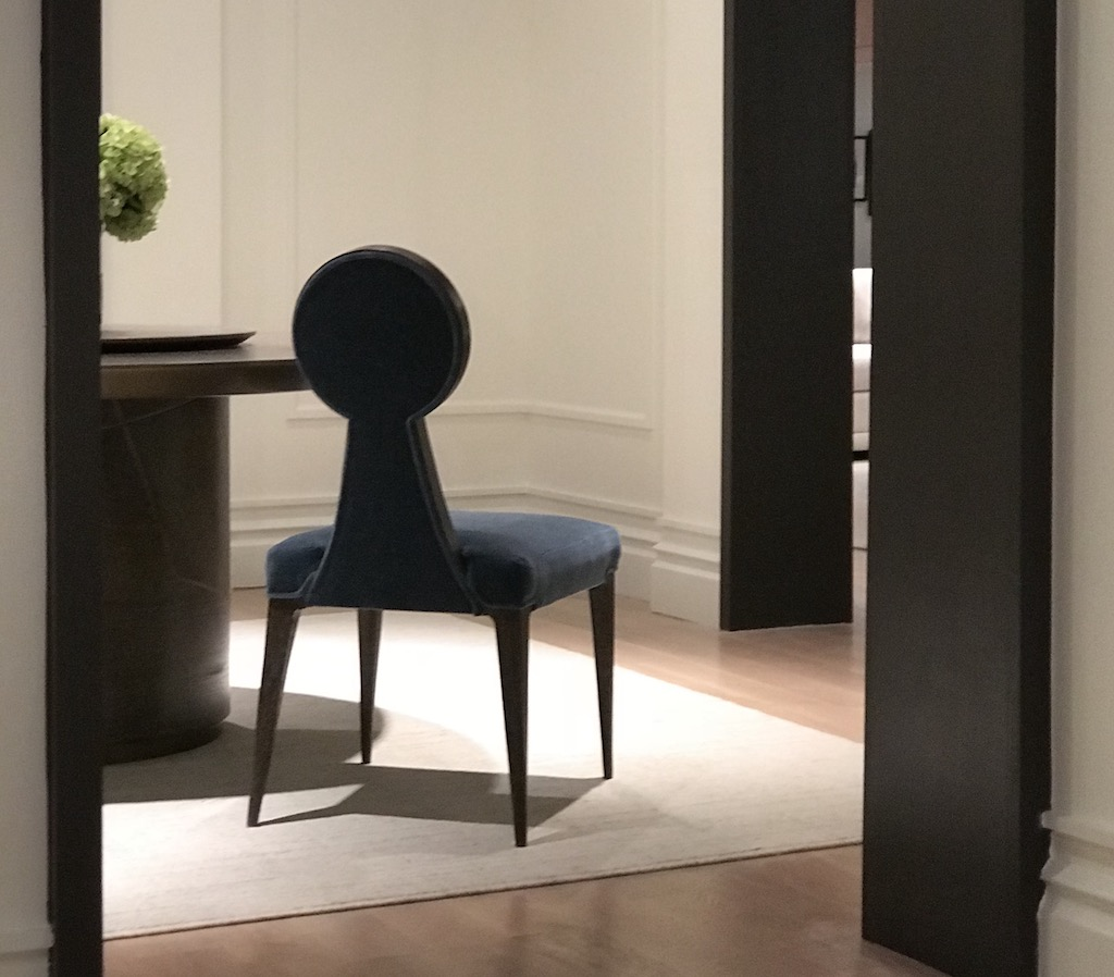 The Ethos Chair in the Xander Noori Collection for Theodore Alexander illustrates how navy is trending globally.