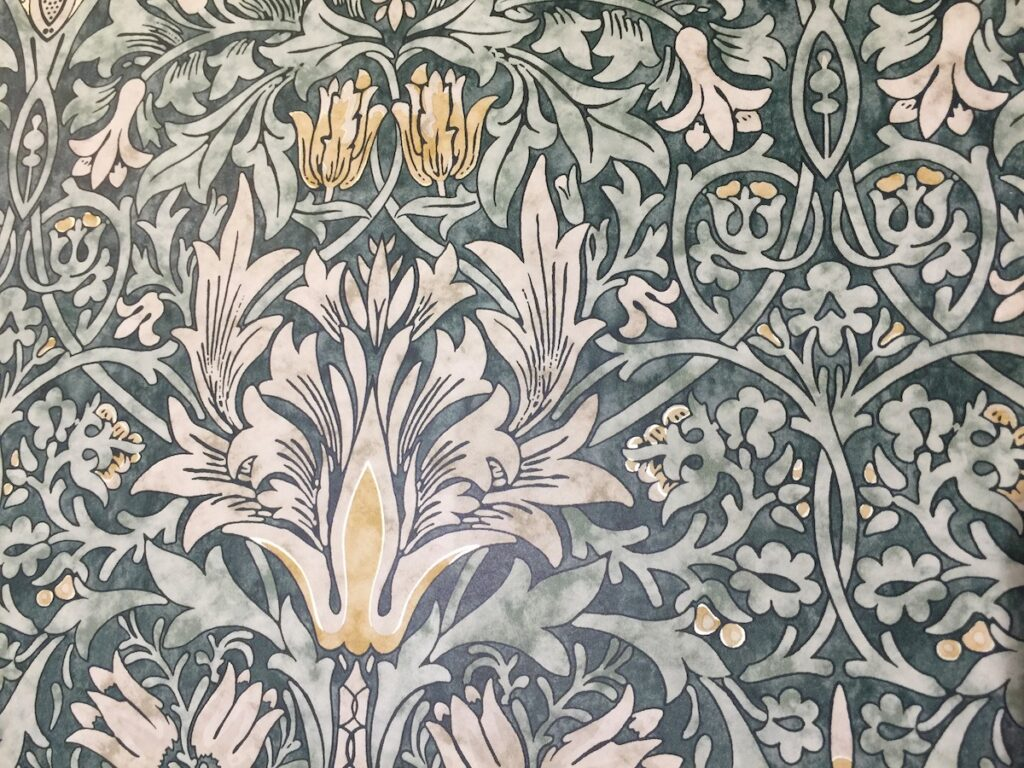 The Snakeshead pattern of wallpaper by William Morris for Style Library.