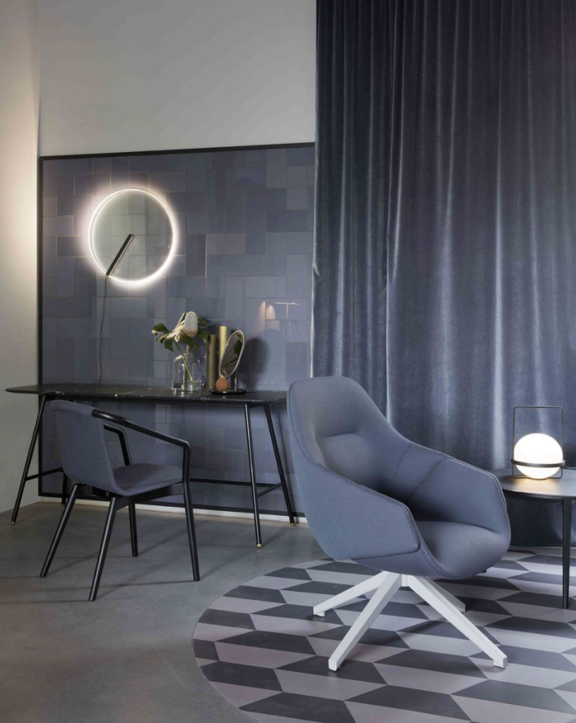 sp01 Design's Anita high-back armchair introduced at Salone del Mobile illustrates how navy is trending globally.