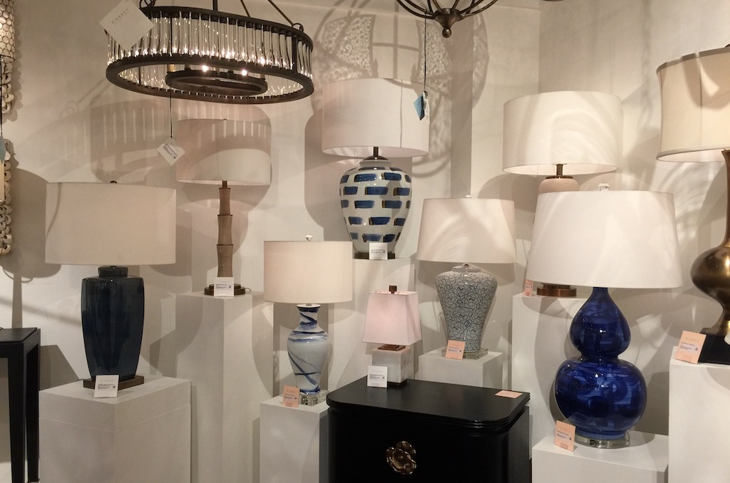 The Currey & Company Kolor table lamp shining blue during Dallas Market.
