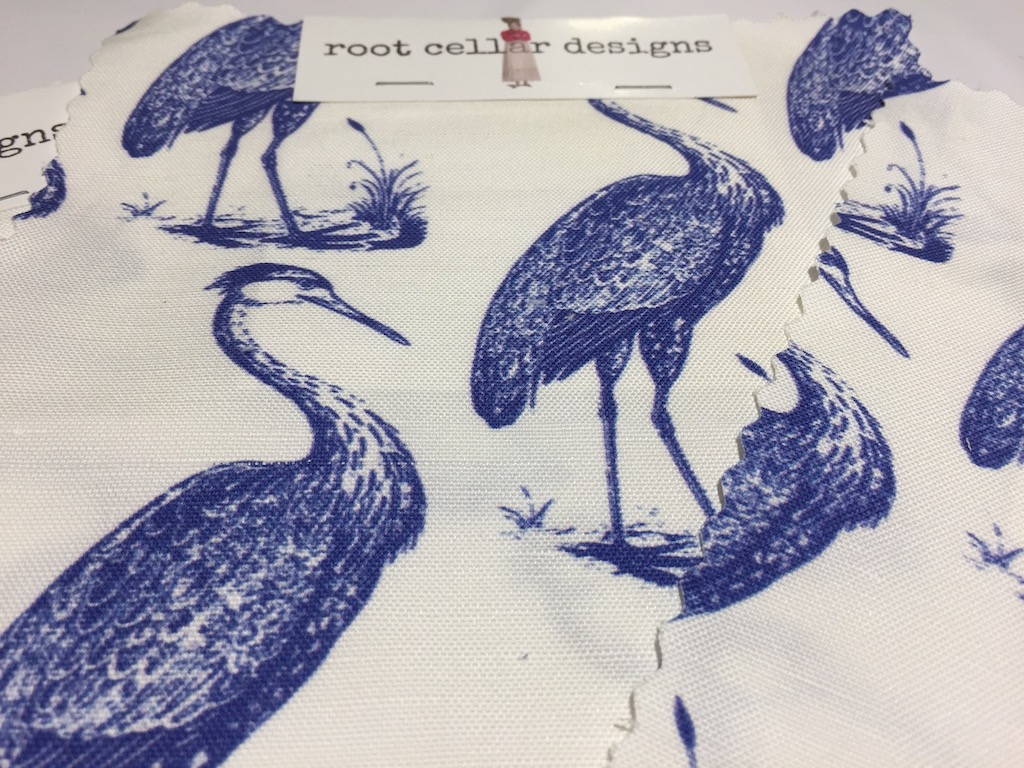 Root Cellar Designs Blue Heron Pattern in white and marine at Dallas Market.
