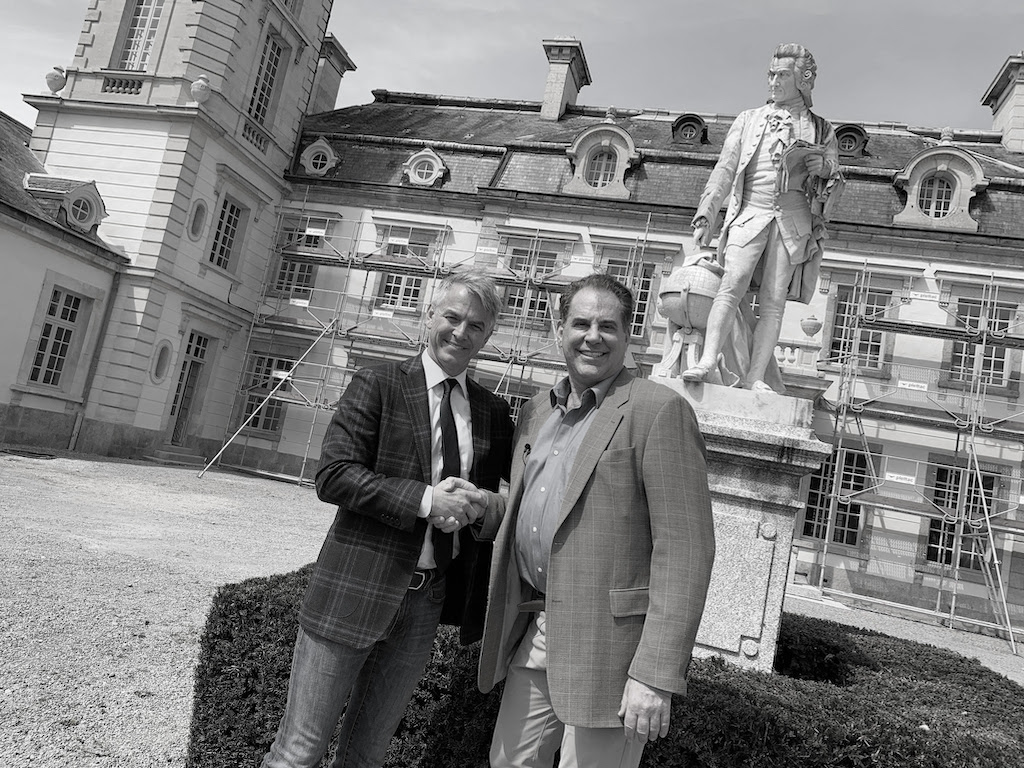Kyle Bunting (left) and Timothy Corrigan (right) in the courtyard of Château de la Chevallerie.