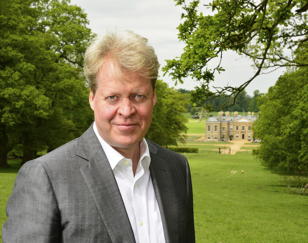 Charles, 9th Earl Spencer, with Althorp, the family estate in the background.