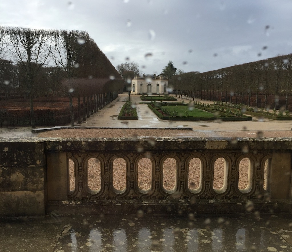 The theater on the grounds of the Petit Trianon from the Grand Dining Room. The rain pelting the windows was visible. Image © Design Diary.
