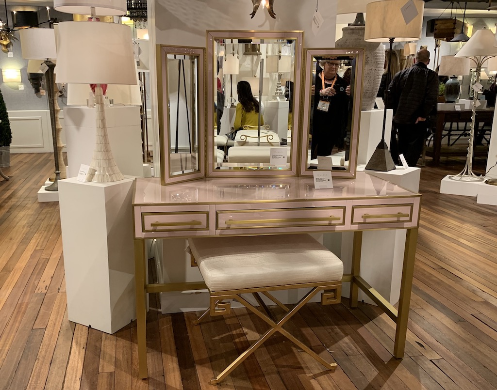 Currey & Company's Arden Vanity and mirror are pink trend standouts.