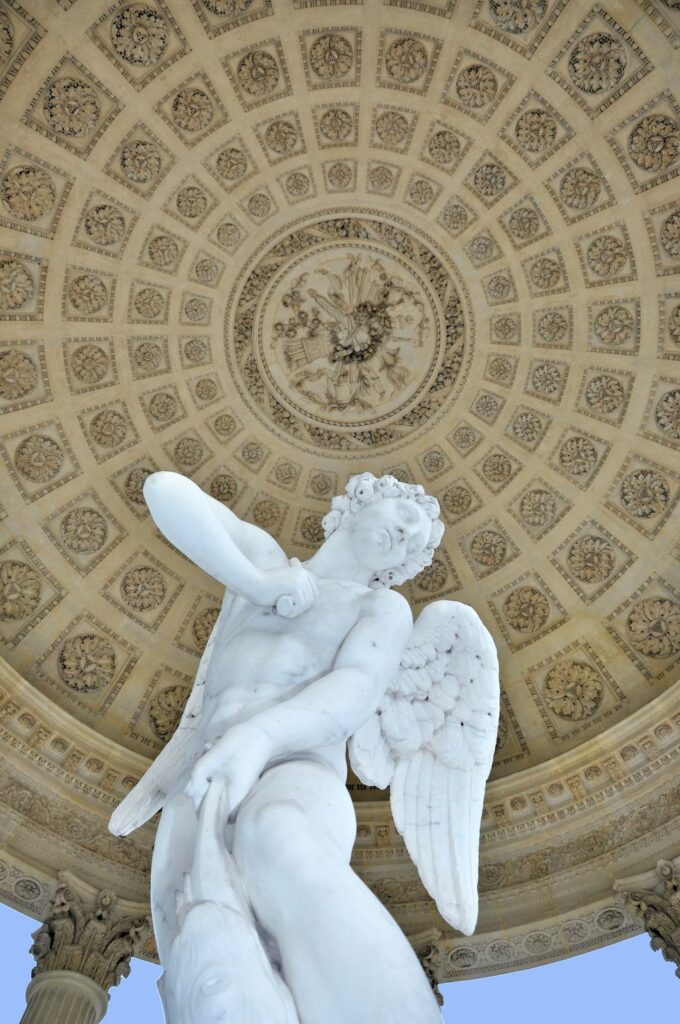A closeup of the statue of cupid that serves as the centerpiece for the folly. Image courtesy WikiMedia and Starus.