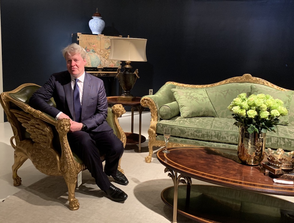 Earl Spencer in an ornate chair during the product launch at Theodore Alexander.