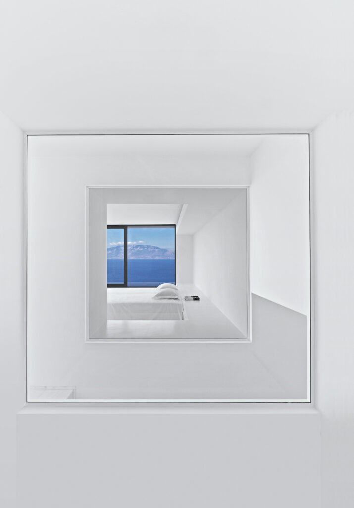 This image is a view of Cephalonia through two windows that surround the staircase from the bathroom of the master suite. Image credit: Serge Anton.
