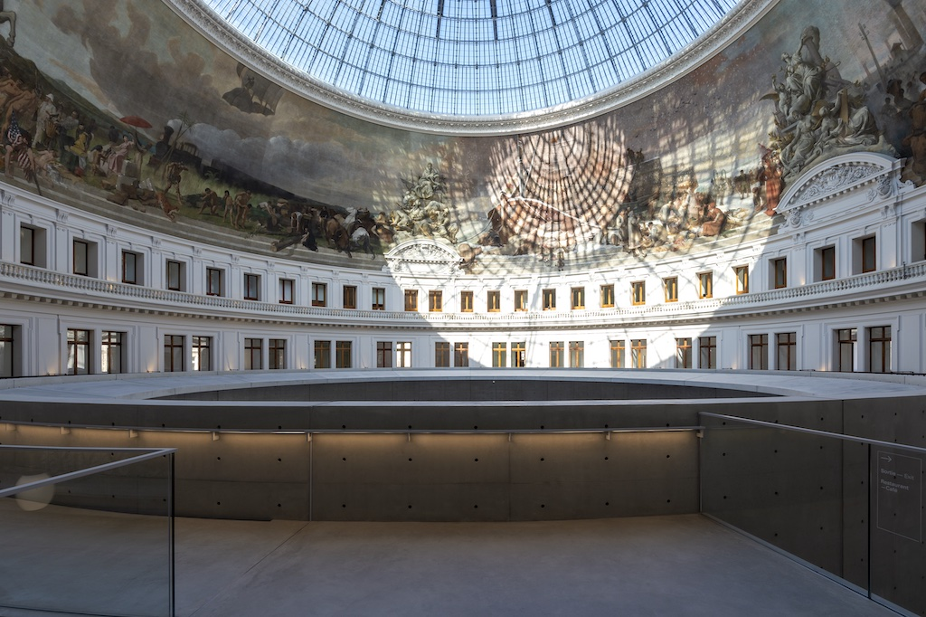 Captured by Marc Domage, the reflection of light through the dome throws patterns on the interior of the building.