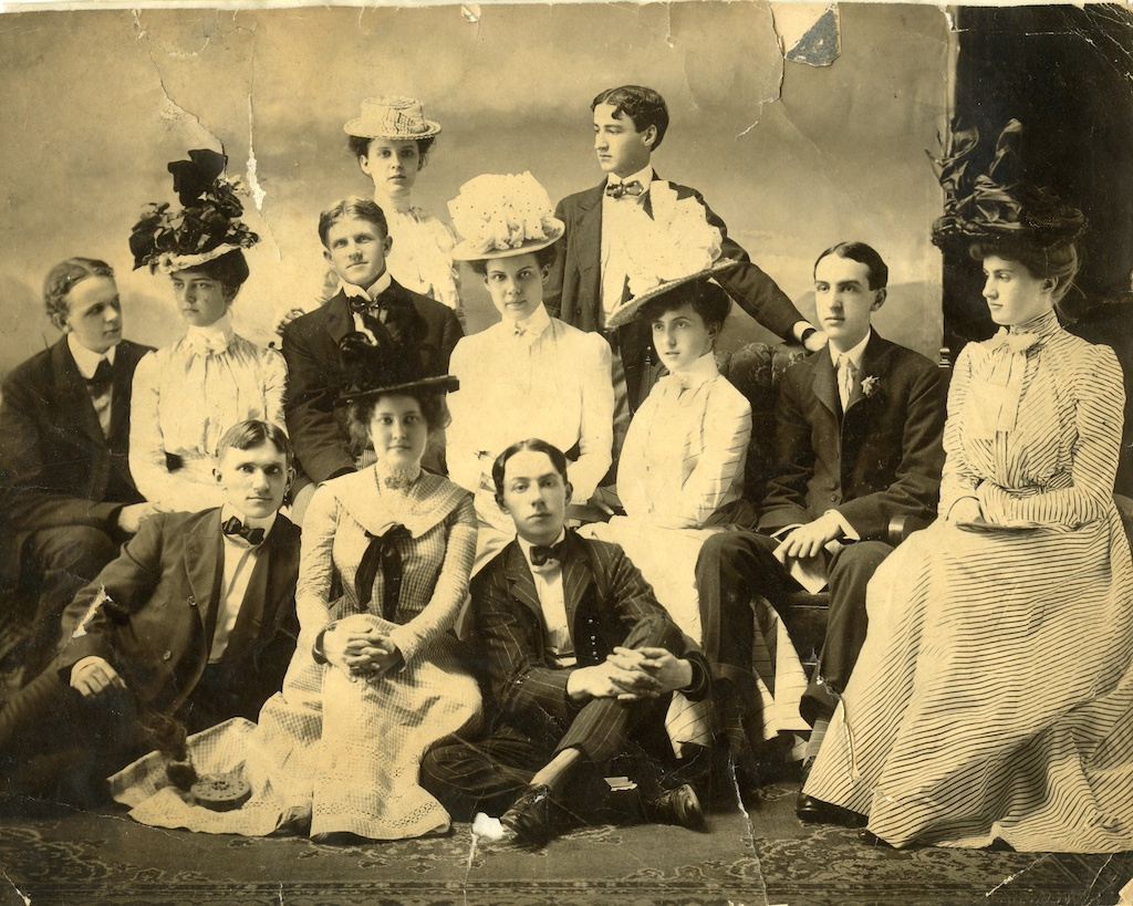 Photograph of Edward H. Inman and guests at a house party probably held in Rome, Georgia at the Inman summer home. Back row, (l-r) Emmie McDougald, Edward Inman. Middle row, (l-r) Austell Thornton, Emmie Johnson Vaugh Nixon, Eugenia Ogelsby, Josie Stockdell, Phinizy Calhoun, and Bessie Draper. Front row (l-r) Arthur Clark, Adelaide Howell, and John Turner.