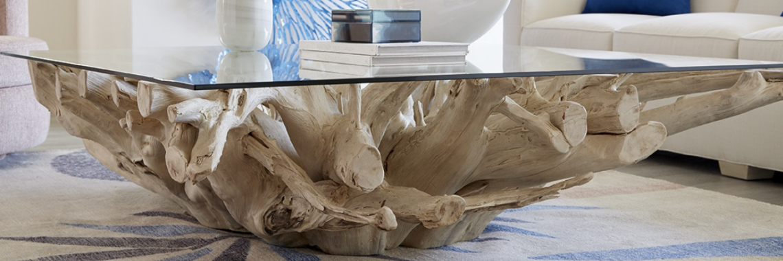 a teak wood coffee table by Phillips Collection